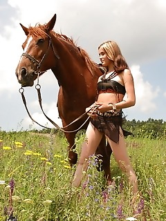 A girl having fun on the horse's back has never been so horny and attractive before.