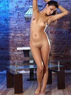 Alluring vanessa angel strips and displays her naked, nubile body as she poses sensually on the couch.