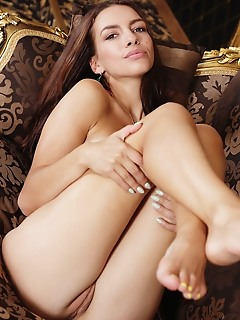 Eos sultry eos bares her trimmed pussy as she strips her lingerie on the couch.