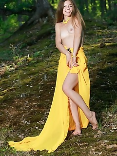 Vivian vivian strips her long, yellow dress baring her tight body and smooth pussy in the forest.