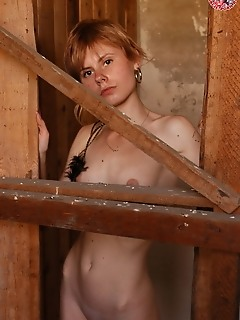 A skinny girl with the sexy look is touching her pussy dreaming of a tough fuck.