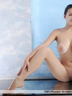 Naked from beginning to end, a ravishing kitty greets us with a perfect view of her smooth, supple labia and delicate tits as she spreads her legs on