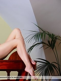 Ekaterina makes sure her best assets, her perfectly shaped, long legs take the limelight as she seductively poses on top of a white cushioned chair.