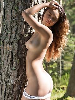 Slava top model slava bares her gorgeous body as she strips in the woods.