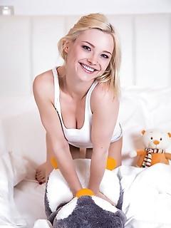 Zazie gorgeous blonde zazie playfully strips on the bed.
