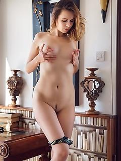 Nasita nasita shows off her luscious body as she poses on the floor.