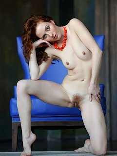 Raena strips her dress baring her sexy body with beautiful breasts and delectable pussy as she poses on the floor.