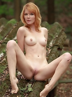 Mia sollis redhead mia sollis poses in the forest baring her slender body and smooth pussy.