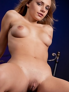 New metart angel with a pretty face and noticeable suckable nipples.