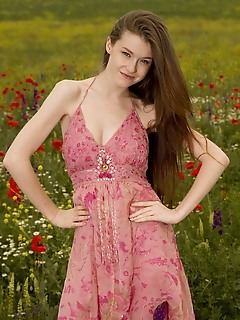 """Emily bloom """"emily blooms charming smile and nubile body stands out in a field of flowers"""""""