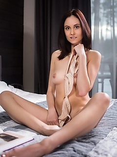 Sade mare sade mare strips on the bed baring her slender body and tight ass.