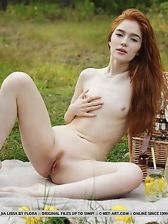 Jia lissa redhead jia lissa strips outdoors as she displays her trimmed pussy.