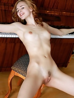 Kitty nice kitty nice bares her beautiful, creamy body as she strips by the piano.