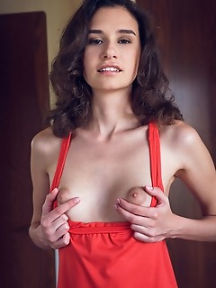 Cristin cristin strips in the bedroom baring her petite body.