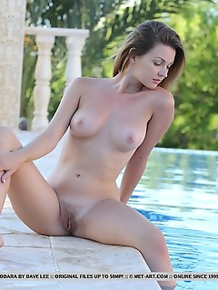 Odara odara strips by the pool baring her creamy body with pink nipples and trimmed pussy.