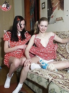 Two horny lesbians undressing their red dresses and fingering their pussies