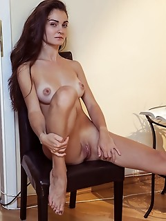 Onorin onorin sensually strips on the chair as she flaunts her tanned body and sweet pussy.