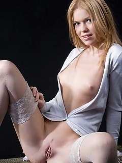 Innocent and refined blonde with natural charms and relaxed personality.