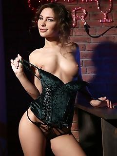 Galina a galina a strips her black corset as she sensually poses at the bar.