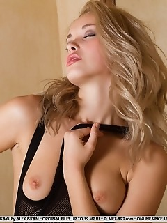 Naughty, playful and seductive blonde in fully erotic poses.