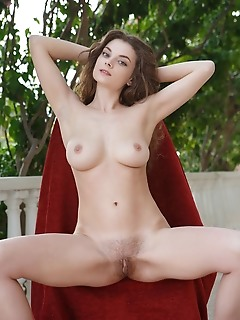 Veronika glam veronika glam displays her unshaven pussy as she poses outdoors.