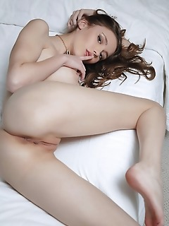 Mila azul new model mila azul sensually poses on bed baring her puffy tits and pink,   delectable pussy.