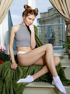 Judith judith sensually strips her crop top and bikini panty by the window.