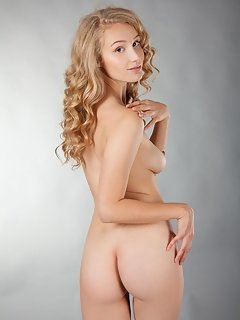 Alina is an interesting combination of sweet yet sexy, garbed in alluring pink camisole with matching panties, garter belt and lacy white stockings, h