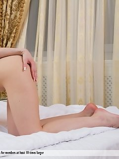 Zsanett tormay shows off her meaty pussy lips