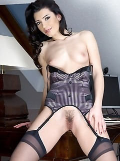 Exotic, lusty, and daring hottie in all-black lingerie and stockings.