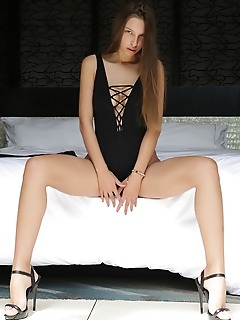 """Elin """"elins long and slender body look stunning in a black body suit and stiletto sandals that shows off her sexy legs"""""""