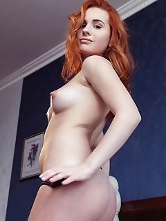 Nicole la cray redhead nicole la cray sensually strips her black lingerie on the bed.
