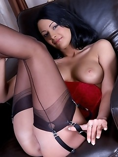 Black-haired new model in sexy black stiletto shoes, sheer black thigh-high stockings, and red lace corset.