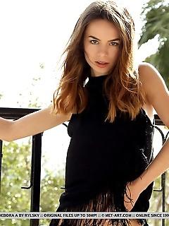 Debora a gorgeous debora a sensually poses in the balcony as she bares her tight body.