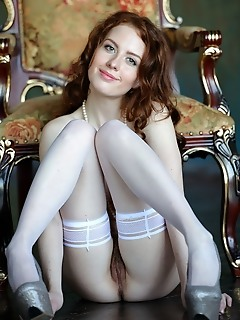 Sienne sienne looks stunning as she poses in her white thigh-high stocking with matching white pearl necklace that accentuate her elegant appeal