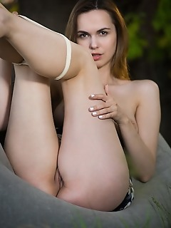 Nasita nasita erotically poses outdoors as she flaunts her lusty body and yummy pussy.