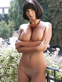 Meaty brunette with magnificent breasts and firm ass.