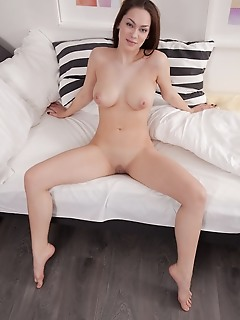 Marion marion spreads her legs wide open baring her delectable pussy on the bed.