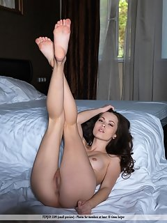 Green-eyed beauty milliki sprawled invitingly on the bed, carefully stripping off her sexy lingerie to flaunt her curvy body