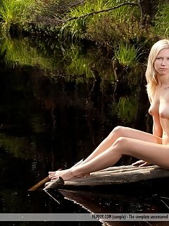 Mila i strips her flowy dress as she bares her long, slender body, tight butt and trimmed pussy in the outdoors.