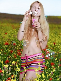"Kendell ""kendell	delightfully poses in the flowery field baring her creamy body."""