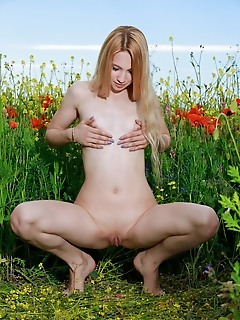 """Kendell """"kendelldelightfully poses in the flowery field baring her creamy body."""""""