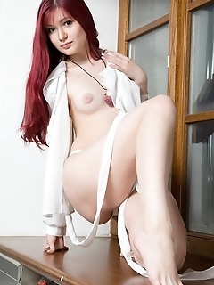 Pale-skinned babe with long, red hair, puffy breasts, untrimmed labia, and meaty ass.