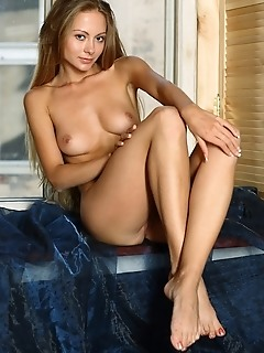 Long-haired beauty with round, cuppable breasts, and long, slender legs.