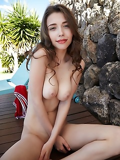 Mila azul mila azul takes off her red bikini and shows off her large breasts with pink nipples, and smooth, shaved pussy