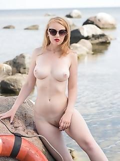 Helene helene poses outdoors as she strips her bikini baring her luscious, creamy body.